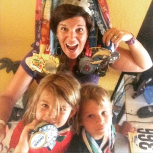 Selfie with a medal. The 2 blonde ones at the bottom are my favorite medals.